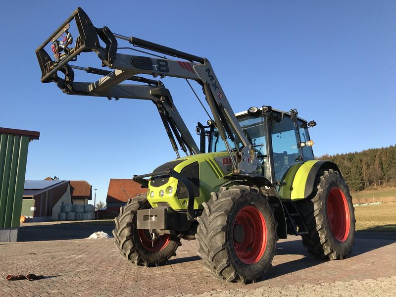 Claas Axos 320 mit Frontlader